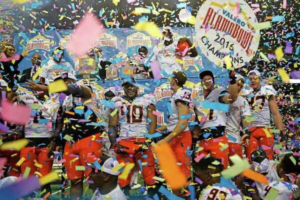 SAN ANTONIO,TX - DECEMBER 29: Oklahoma State Cowboys celebrate their victory over the Colorado Buffaloes in the Valero Alamo Bowl at the Alamodome on December 29, 2016 in San Antonio, Texas.