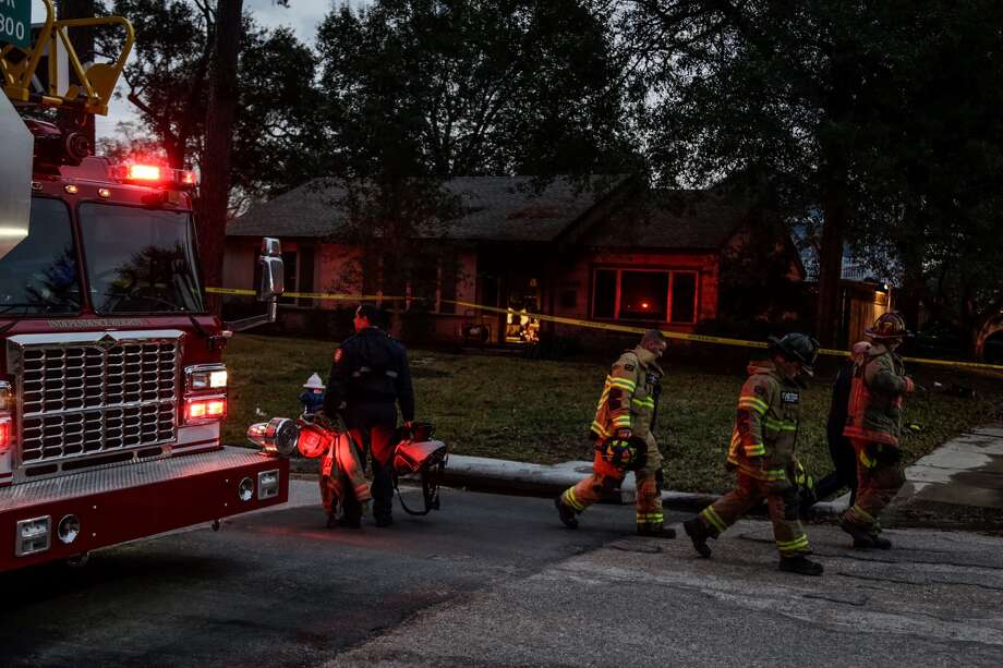 Three people were found dead after firefighters responded to a house fire about 5:30 a.m. Friday, Dec. 30, 2016, at a home in the 1300 block of Richelieu in northwest Houston. (James Nielsen/Houston Chronicle)