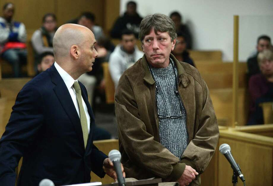 New Canaan resident Mark Lynch is arraigned in Norwalk Superior Court for manslaughter while accompanied by his attorney, Matthew Maddox, Dec. 2. Lynch allegedly gave his son, Chris Lynch, the heroin that killed him in September. Photo: Erik Trautmann / Hearst Connecticut Media / Norwalk Hour