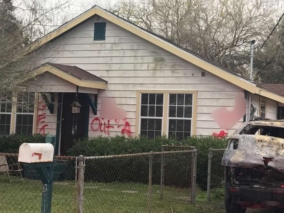Racial slurs were found sprayed painted on a house and burning sports utility vehicle parked in the driveway about 4:30 a.m. Friday, Dec. 30, 2016, in the 300 block of San Jacinto in the Highlands area in east Harris County. (Harris County Fire Marshal's Office)