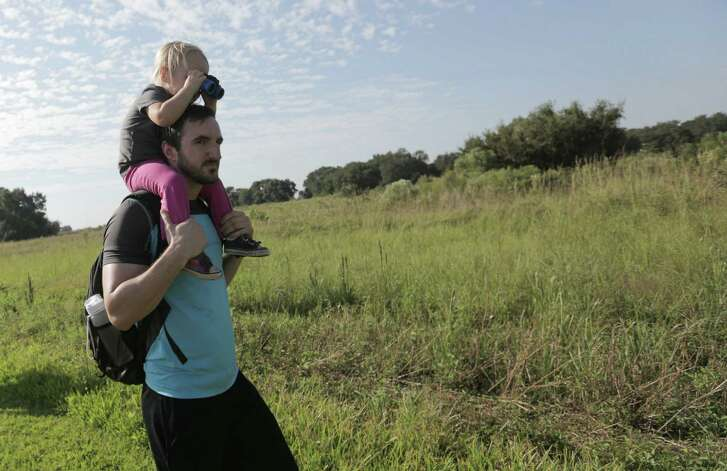 Lucy Heerrsen, 2, and her uncle, Garrott Zylicz, take in the sights at Brazos Bend State Park. First Day Hikes events are planned at 80 state parks.