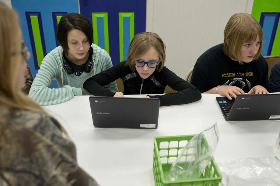 From left: 12-year-old Sophia Waugh, 12-year-old Ellarie Ryals and 13-year-old Marissa Berghuis, all of Midland, look at designs that have been printed on a 3D printer during The ROCK Center for Youth Development's Winter Break Blitz at the Greater Midland Community Center Thursday. AmeriCorps Volunteer In Service to America member Ben Martinson brought his 3D printer to show students how it works and how it turns 2D design into 3D objects as part of The ROCK's new STEM program, ROCKit. Photo: Brittney Lohmiller/Midland Daily News/Brittney Lohmiller