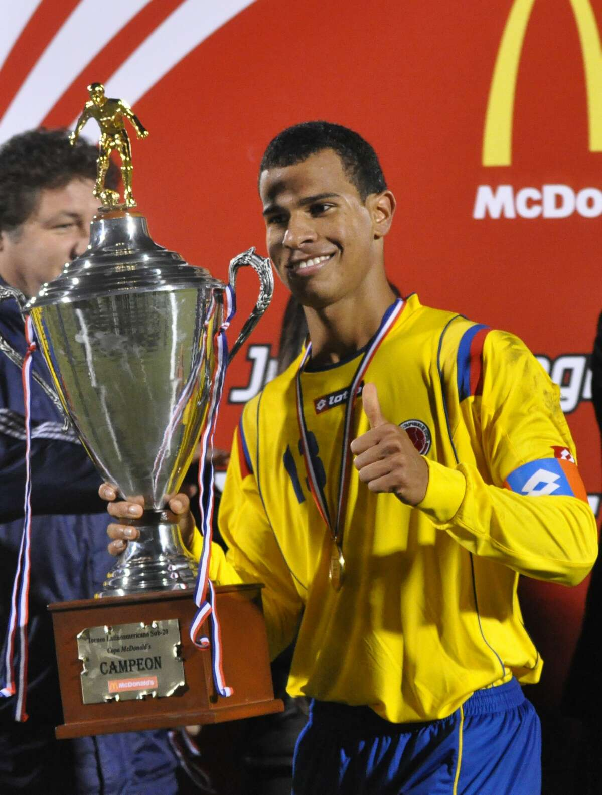 Colombia's Juan David Cabezas holds the trophy after the team beat Argentina in the Latin American Integration Under-20 tournament final soccer match in Asuncion July 31, 2010. AFP PHOTO / NORBERTO DUARTE (Photo credit should read NORBERTO DUARTE/AFP/Getty Images)