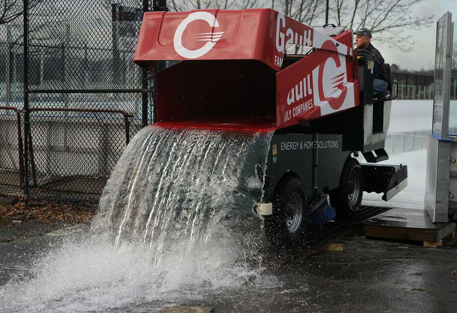 Tony Lantier uses a Zamboni to remove water from the ice following a morning rain at the Westport Police Athletic League rink at Longshore on Dec 27. The rink is open for skating from 11 a.m. to 10 p.m. seven days a week during the holiday season. Photo: Brian A. Pounds / Hearst Connecticut Media / Connecticut Post