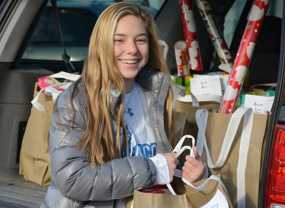 Carolina Salvatore of New Canaan delivers bags of canned food and holiday items to Person-to-Person on Dec. 16. Photo: Contributed Photo