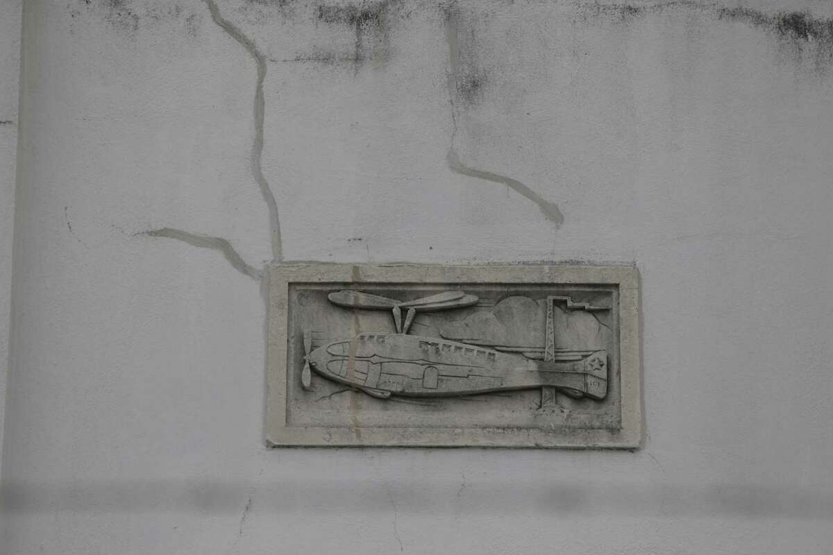 A frieze showing the history of aviation outside the 1940 terminal museum.