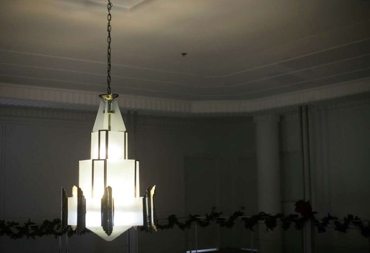 The original chandelier hung in the building even for the 20 years it was abandoned and empty.
