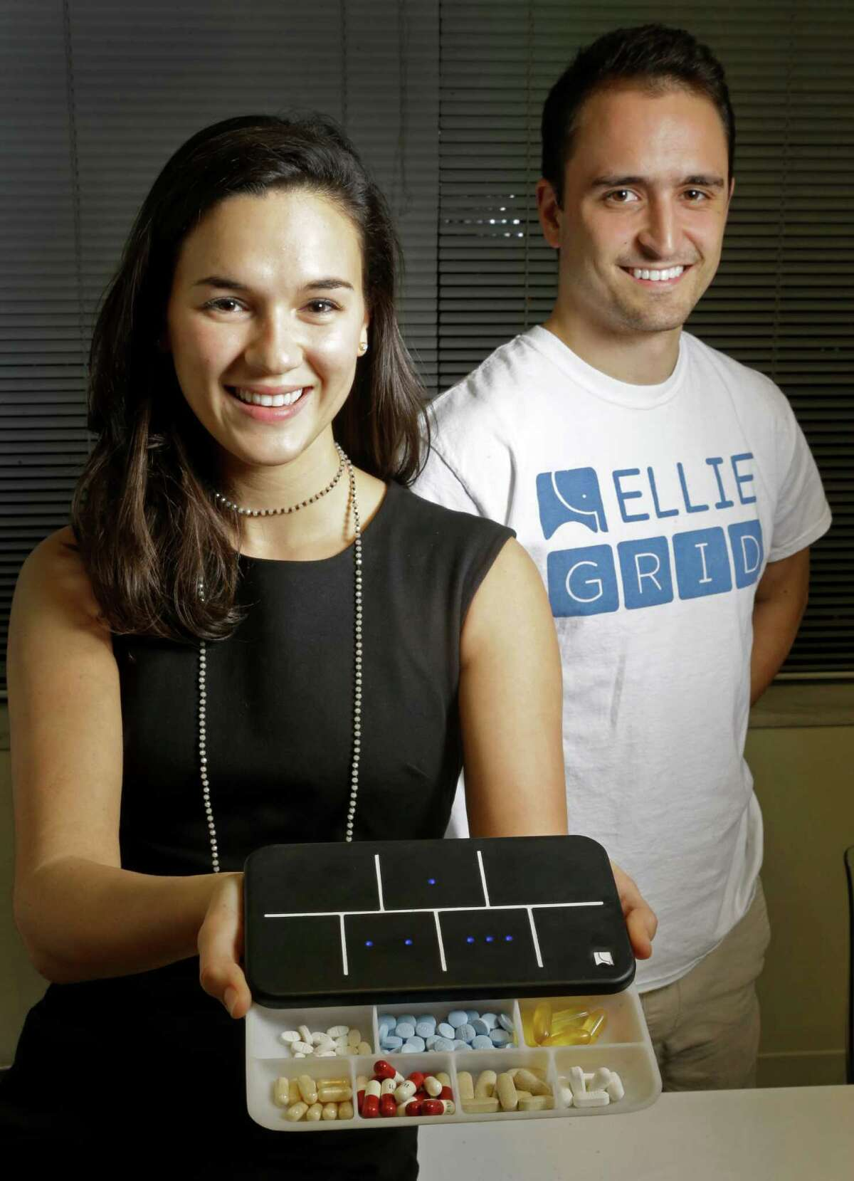 Regina Vatterott, left, and Abe Matamoros, right, pose with a prototype of Ellie Grid, a smart pillbox, which was designed to make taking pills and organizing them more efficient shown Thursday, Dec. 1, 2016, in Houston. ( Melissa Phillip / Houston Chronicle )