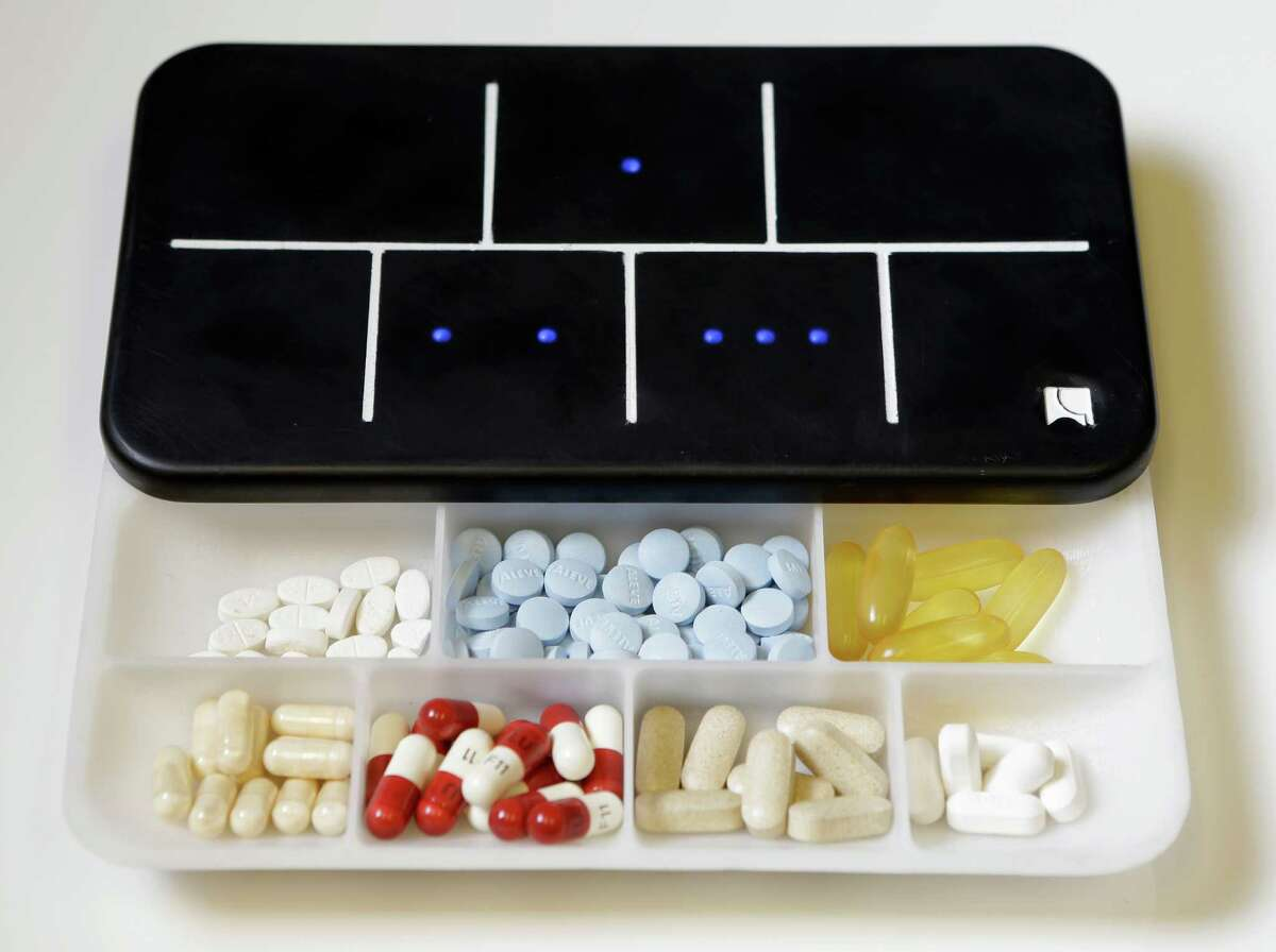 A prototype of Ellie Grid, a smart pillbox, which was designed by Regina Vatterott Abe Matamoros to make taking pills and organizing them more efficient shown Thursday, Dec. 1, 2016, in Houston. ( Melissa Phillip / Houston Chronicle )