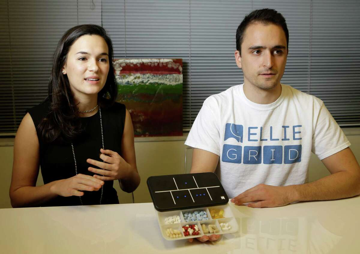 Regina Vatterott, left, and Abe Matamoros, right, talk about the prototype of Ellie Grid, a smart pillbox, which was designed to make taking pills and organizing them more efficient shown Thursday, Dec. 1, 2016, in Houston. ( Melissa Phillip / Houston Chronicle )