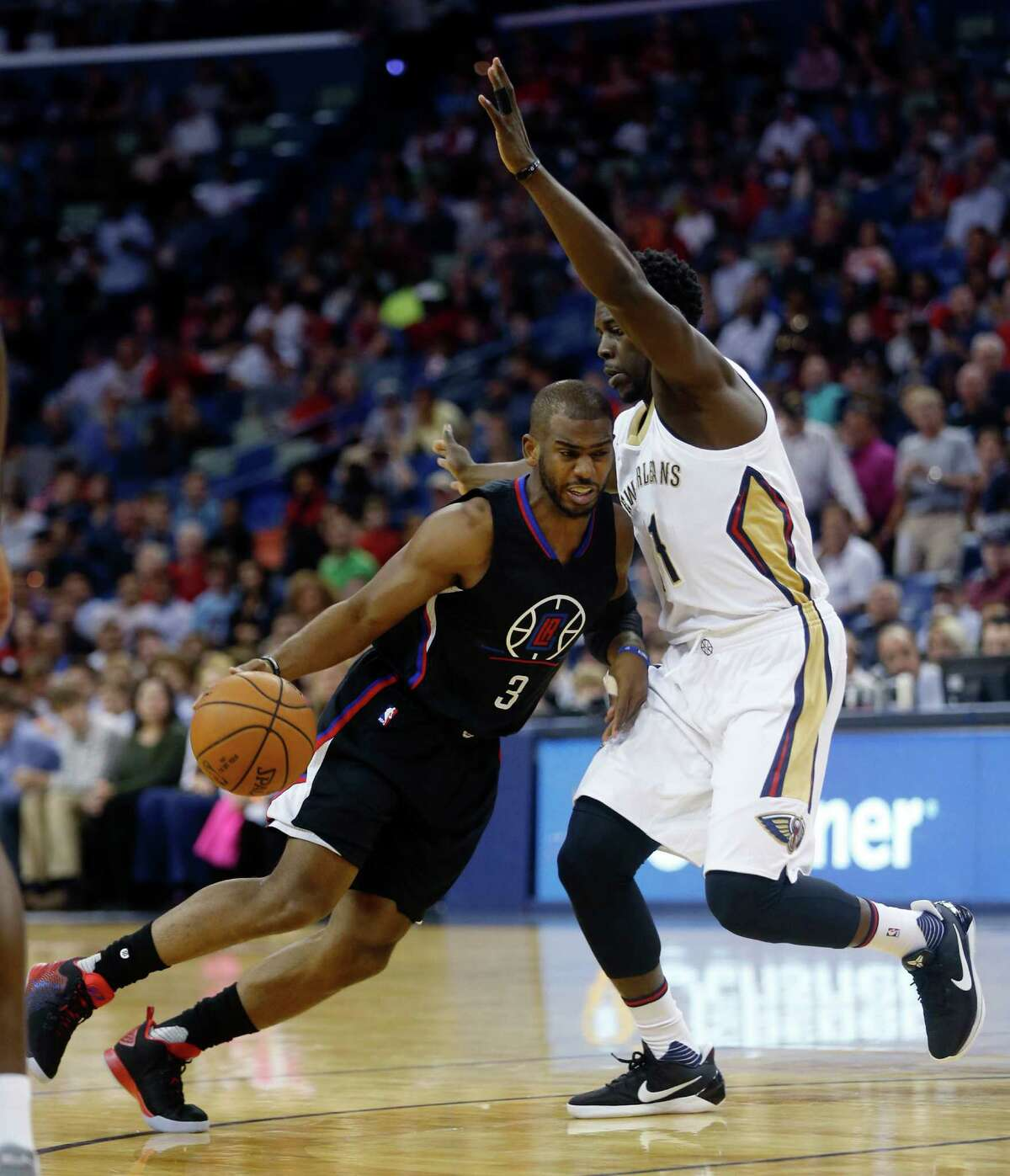Los Angeles Clippers guard Chris Paul (3) drives to the basket againstguard Jrue Holiday (11) in the first half of an NBA basketball game in New Orleans, Wednesday, Dec. 28, 2016. (AP Photo/Gerald Herbert)