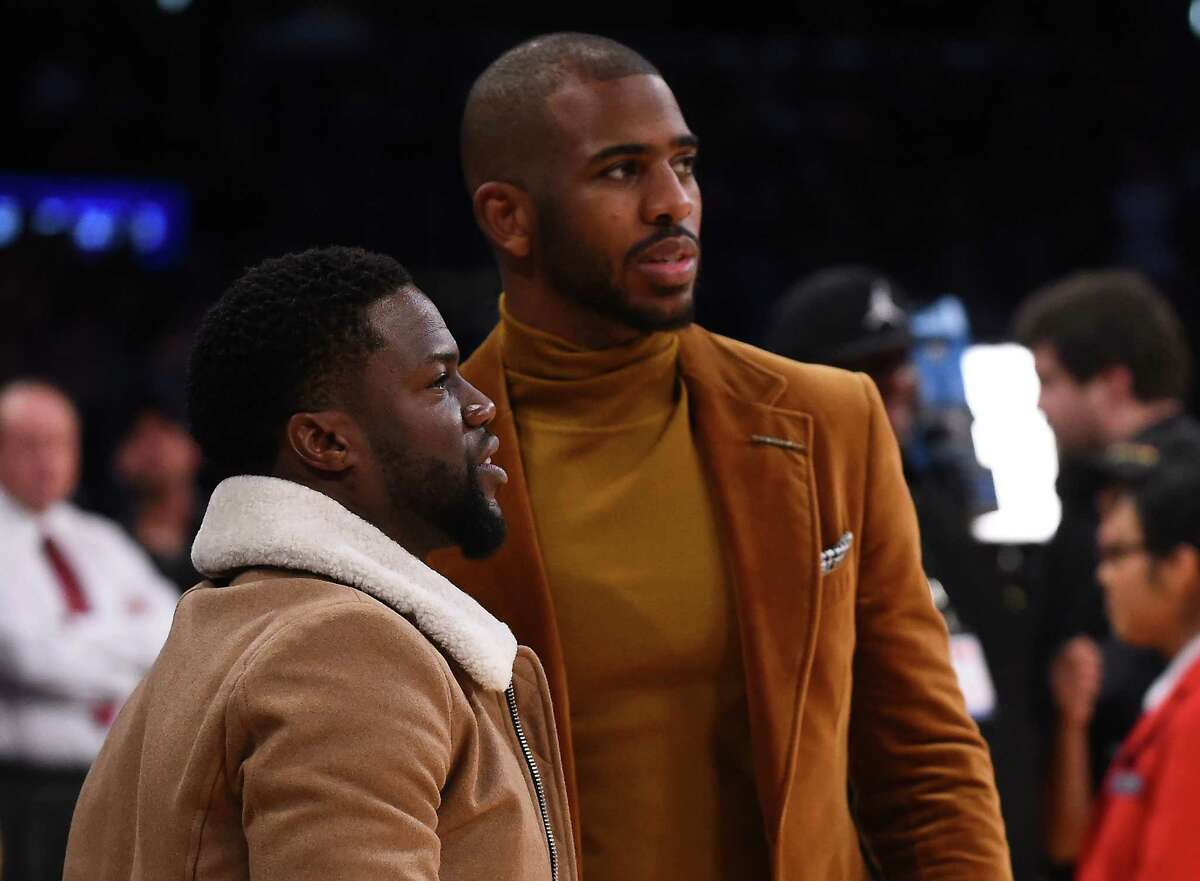 LOS ANGELES,CA - DECEMBER 25: Chris Paul #3 of the Los Angeles Clippers talks with actor Kevin Hart during the game against the Los Angeles Lakers at Staples Center on December 25, 2016 in Los Angeles, California. The Los Angeles Lakers won 111-102. NOTE TO USER: User expressly acknowledges and agrees that, by downloading and or using this photograph, User is consenting to the terms and conditions of the Getty Images License Agreement.
