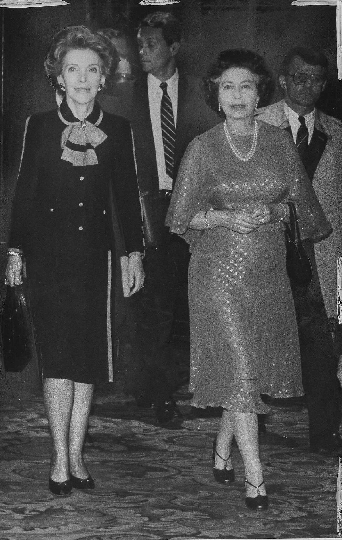 Queen Elizabeth II of Great Britain visits San Francisco. She is seen here with First lady Nancy Reagan in the St Francis Hotel lobby, on their way to dinner, March 2, 1983 Photo ran 03/03/1983, p. 21