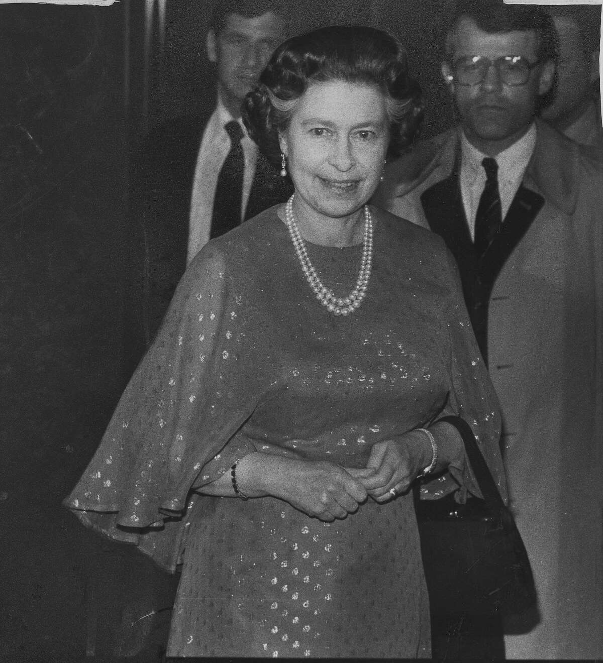 Queen Elizabeth II of Great Britain visits San Francisco. She is seen here in the St Francis Hotel lobby, on their way to dinner, March 2, 1983 Photo ran 03/03/1983, p. 13