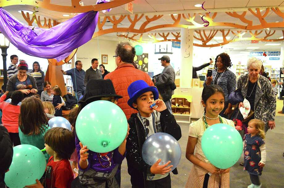Balloons and noise makers marked the Fairfield Library's Happy Noon Year celebration, Friday, Dec. 30, 2016, in Fairfield, Conn. Photo: Jarret Liotta / For Hearst Connecticut Media / Fairfield Citizen News Freelance