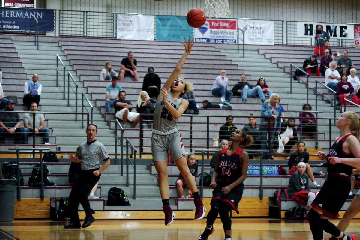 Pearland's Jocelyn Thompson finds an opening to the basket in a non-district girls' basketball game against Clear Lake.
