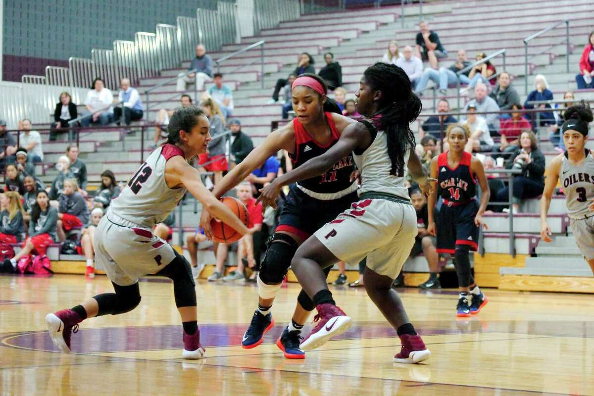 Clear Lake's Dominic Smauldon (center) is trapped by Pearland's Julia Gonzales (12) and Leslie Nichols (11) during a non-district girls' basketball game.