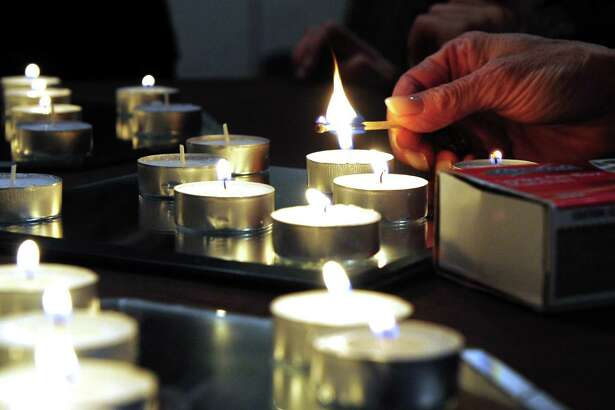 Congregants light candles before the onset of the Jewish holiday of Yom Kippur held at Chabad of Fairfield on Tuesday Oct. 11, 2016. Yom Kippur is observed as a Day of Atonement and begins at sundown with fasting until sundown the next day.
