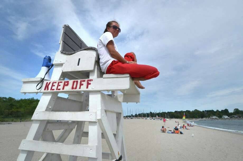 Lifeguard Maria Onischenko watches over the beach from her chair at Jennings Beach  Photo: Alex Von Kleydorff / Hearst Connecticut Media / Connecticut Post