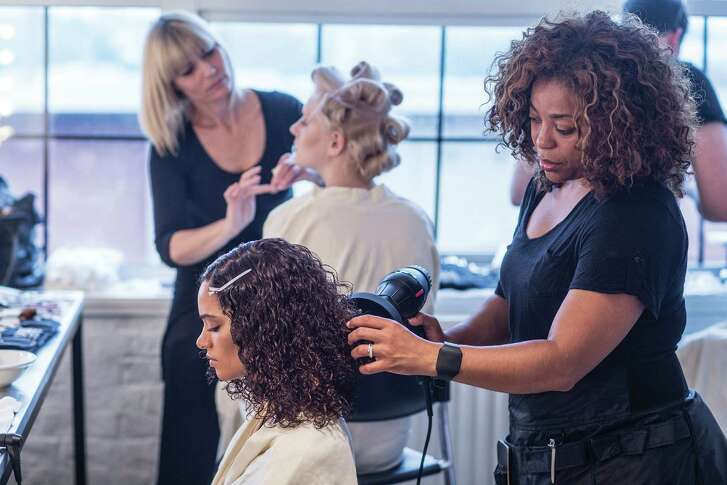"Tippi Shorter, right, Aveda's global artistic director for textured hair, says confidence is the key to working with hair with ""texture,"" whether keeping it curly or styling it sleek. She has a celebrity-filled client list."