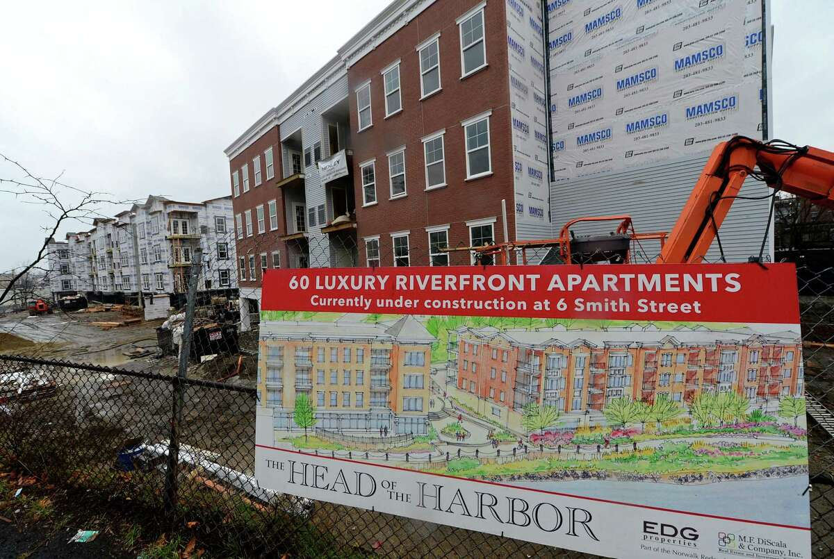 Ongoing construction at Head-of-the-Harbor South on upper Smith Street Thursday, December 29, 2016, in Norwalk, Conn. Driven by ongoing apartment construction, the year 2016 marked a near-record year in the city of Norwalk in terms of zoning and building permits issued. But not all approvals made it to groundbreaking by the close of the year and at least one, Wall Street Place, ground to a halt mid-year.