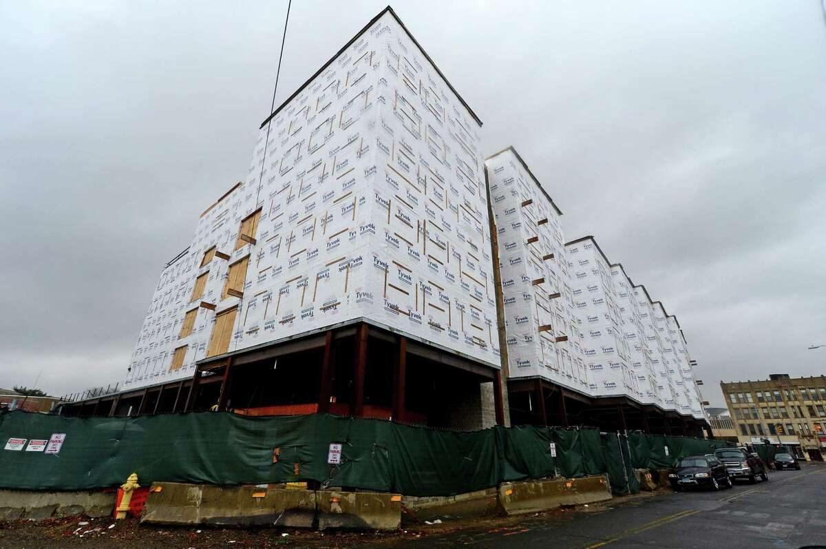 Halted construction at the Wall Street Place development on Wall Street, Thursday, December 29, 2016, in Norwalk, Conn. Driven by ongoing apartment construction, the year 2016 marked a near-record year in the city of Norwalk in terms of zoning and building permits issued. But not all approvals made it to groundbreaking by the close of the year and at least one, Wall Street Place, ground to a halt mid-year.