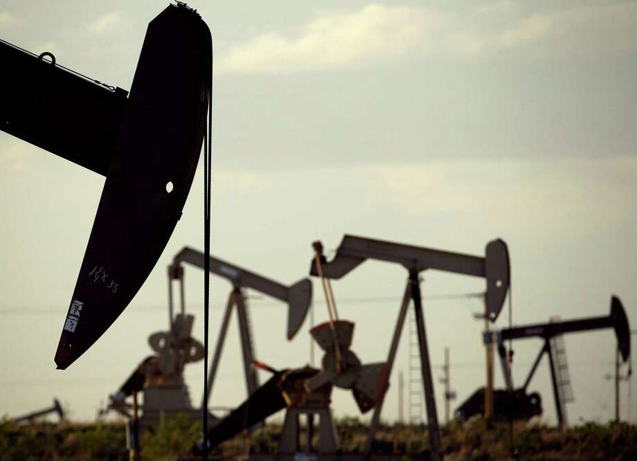 Pump jacks work in a field near Lovington, N.M., in 2015. Oil becomes gasoline, an increased tax on which a reader suggests is unnecessary. Photo: Associated Press File Photo / AP
