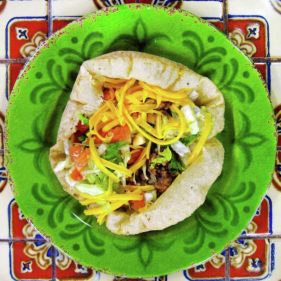 Puffy taco with beef from Teka Molino on San Pedro Avenue. Photo: Mike Sutter /San Antonio Express-News