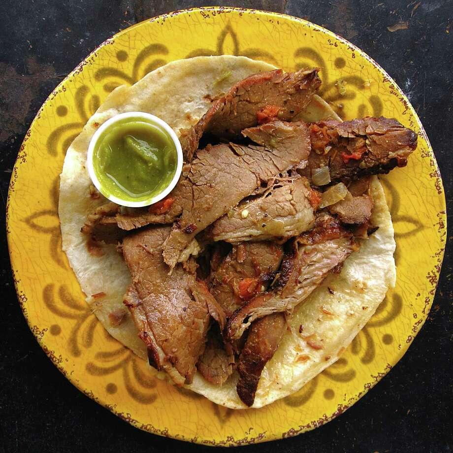 Brisket taco on a handmade flour tortilla from Chas Market & Kitchen on North Pine Street in San Antonio. Photo: Mike Sutter /San Antonio Express-News