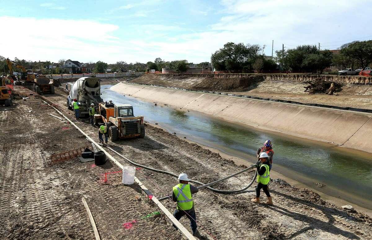 Construction crews work to expand Brays Bayou, Thursday, Dec. 29, 2016, in Houston.