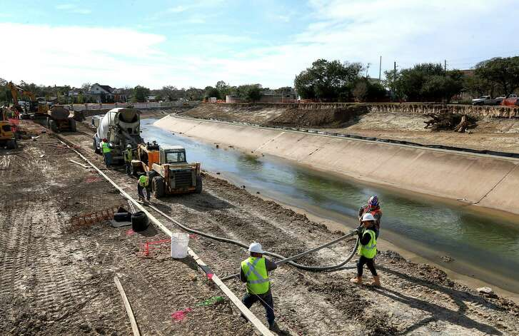 Construction crews work to expand Brays Bayou, Thursday, Dec. 29, 2016, in Houston.