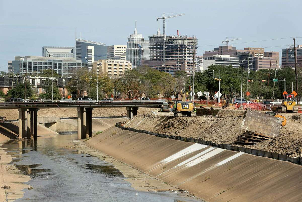 What will it take to fix the Houston floods? A lot. It mostly comes down to making space for the water and investing in drainage infrastructure. Pictured:Construction crews work to expand Brays Bayou, Thursday, Dec. 29, 2016, in Houston.