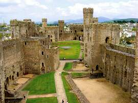 A huge green courtyard is one of the highlights of Caernarfon Castle.