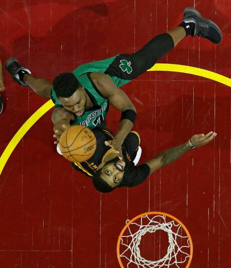 Boston's Jaylen Brown, top, shoots over Cleveland's Kyrie Irving in the first half of an NBA basketball game, Thursday, Dec. 29, 2016, in Cleveland. Photo: Tony Dejak /Associated Press