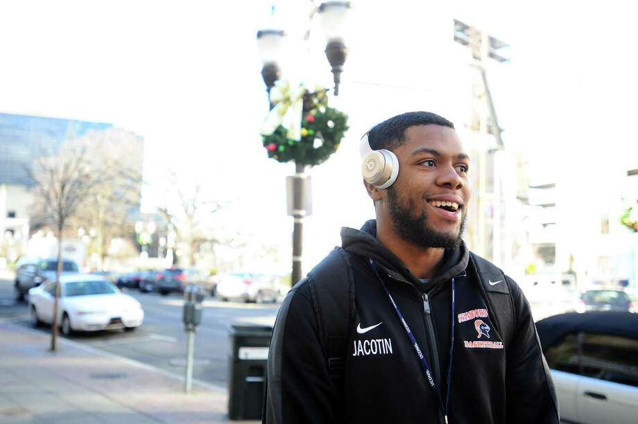Joe Jacotin, a student at Southern Connecticut State University, talks about his new year's resolutions on Main Street in Stamford. Photo: Michael Cummo / Hearst Connecticut Media / Stamford Advocate