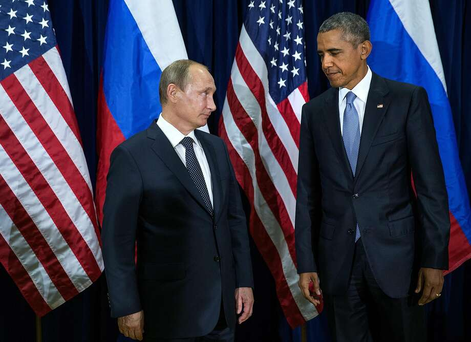 FILE — President Barack Obama and President Vladimir Putin of Russia at the United Nations in New York, Sept. 28, 2015. Putin, skilled at keeping several steps ahead of his adversaries, announced that he would not retaliate in kind against the Obama administration for imposing new sanctions and expelling Russian diplomats from the United States. (Doug Mills/The New York Times) Photo: DOUG MILLS, NYT