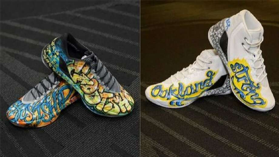 "The Stephen Curry game-worn shoes — with ""Oakland Strong"" on them — sold online for $30,101. The ""Ghost Ship"" shoes brought a winning bid of $15,100. All the money raised will go to the Oakland Fire Relief Fund. Photo: Courtesy Of The Warriors"