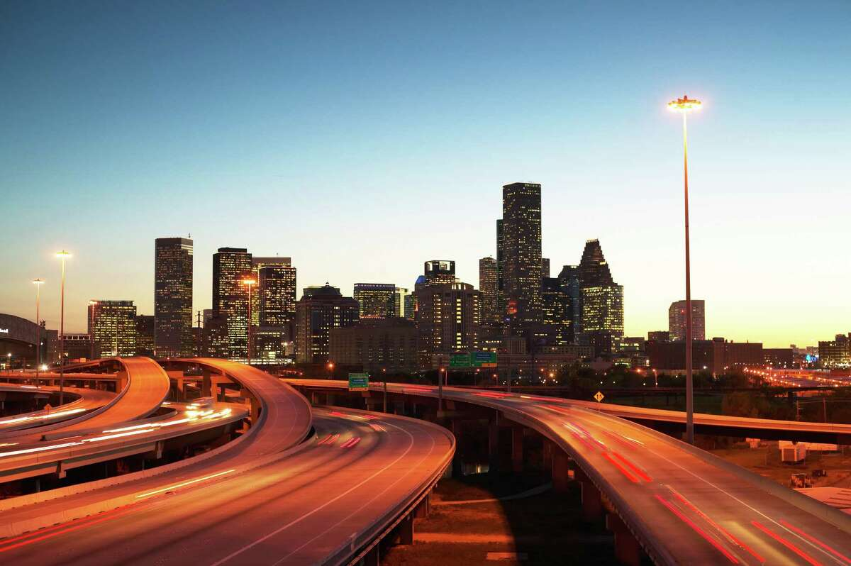 USA, Texas, Houston skyline, motorway, dusk