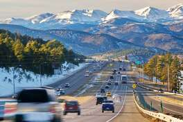 Cars head toward the mountains in Denver. Denver made at least one list of top travel destinations for 2017.