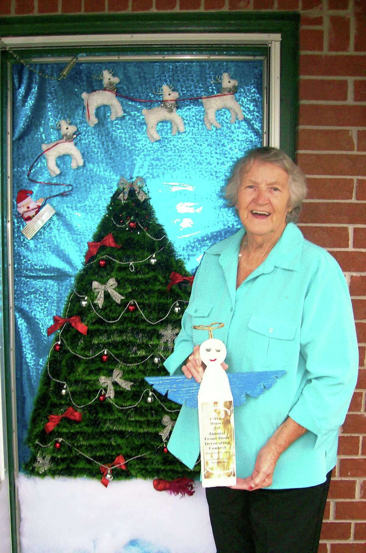 Azalea Terrace residents in Cleveland showed their creativity in a door decorating contest for the Christmas season. In first place was Patsy McMenamy whose apartment door was adorned by a Christmas tree with reindeer flying in the night sky. The contest was judged by Ashleigh Broussard and Vanesa Brashier.