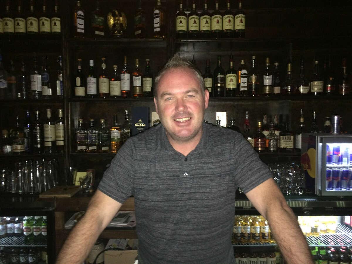 Daire O'Conner tending bar. Hoodline