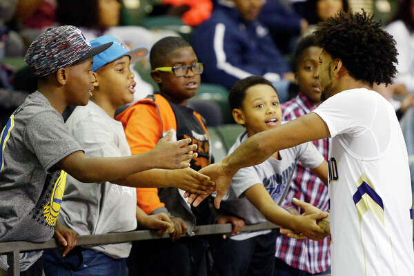 Midland High's Courtney McMaryion (1) shakes hands with young fans after a win against Plainview in the final day of the Byron Johnston Holiday Classic on Friday, Dec. 30, 2016, at Chaparral Center.  James Durbin/Reporter-Telegram