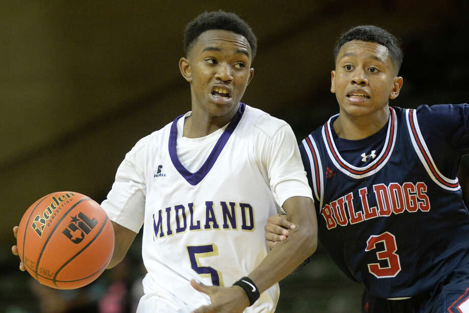 Midland High's Ty Kendrick (5) runs the ball against Plainview's Tayvian Coleman (3) in the final day of the Byron Johnston Holiday Classic on Friday, Dec. 30, 2016, at Chaparral Center.  James Durbin/Reporter-Telegram Photo: James Durbin