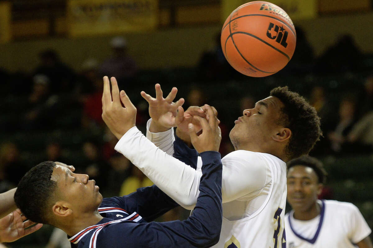 Midland High's Joseph Barron (34) goes after a rebound against Plainview's Tayvian Coleman (3) in the final day of the Byron Johnston Holiday Classic on Friday, Dec. 30, 2016, at Chaparral Center. James Durbin/Reporter-Telegram
