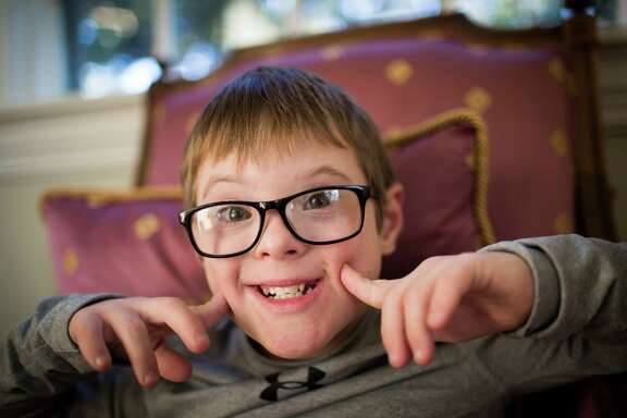Sam Bullion, 10, a student in Austin who has Down syndrome, has regressed since being denied services, his mother, Melissa Ferrell, says.