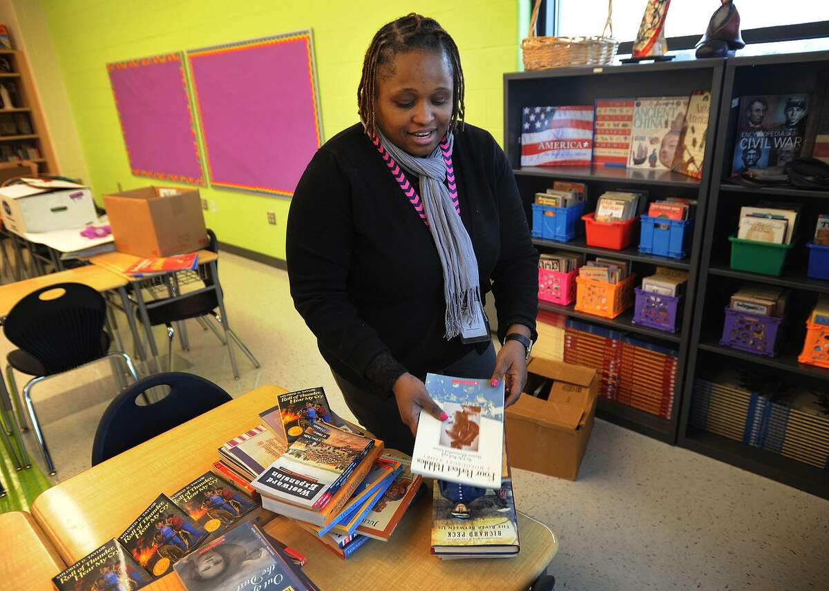 Seventh and eighth grade social studies teacher Diane Isaac sets up her classroom at the new Geraldine Claytor Magnet School in Bridgeport, Conn. on Wednesday, December 21, 2016. The school replaces the old Longfellow School, which closed four years ago.