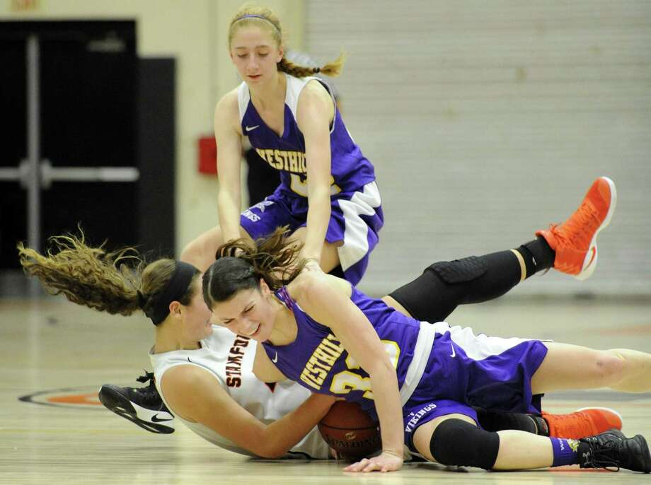 Westhill Olivia Wise and Stamford Alexa Kellner battle for a loose ball in the finals of the Kuczo girls basketball tournament at Stamford High School on Dec. 30, 2016. Stamford defeated Westhill 63-33. Photo: Matthew Brown / Hearst Connecticut Media / Stamford Advocate