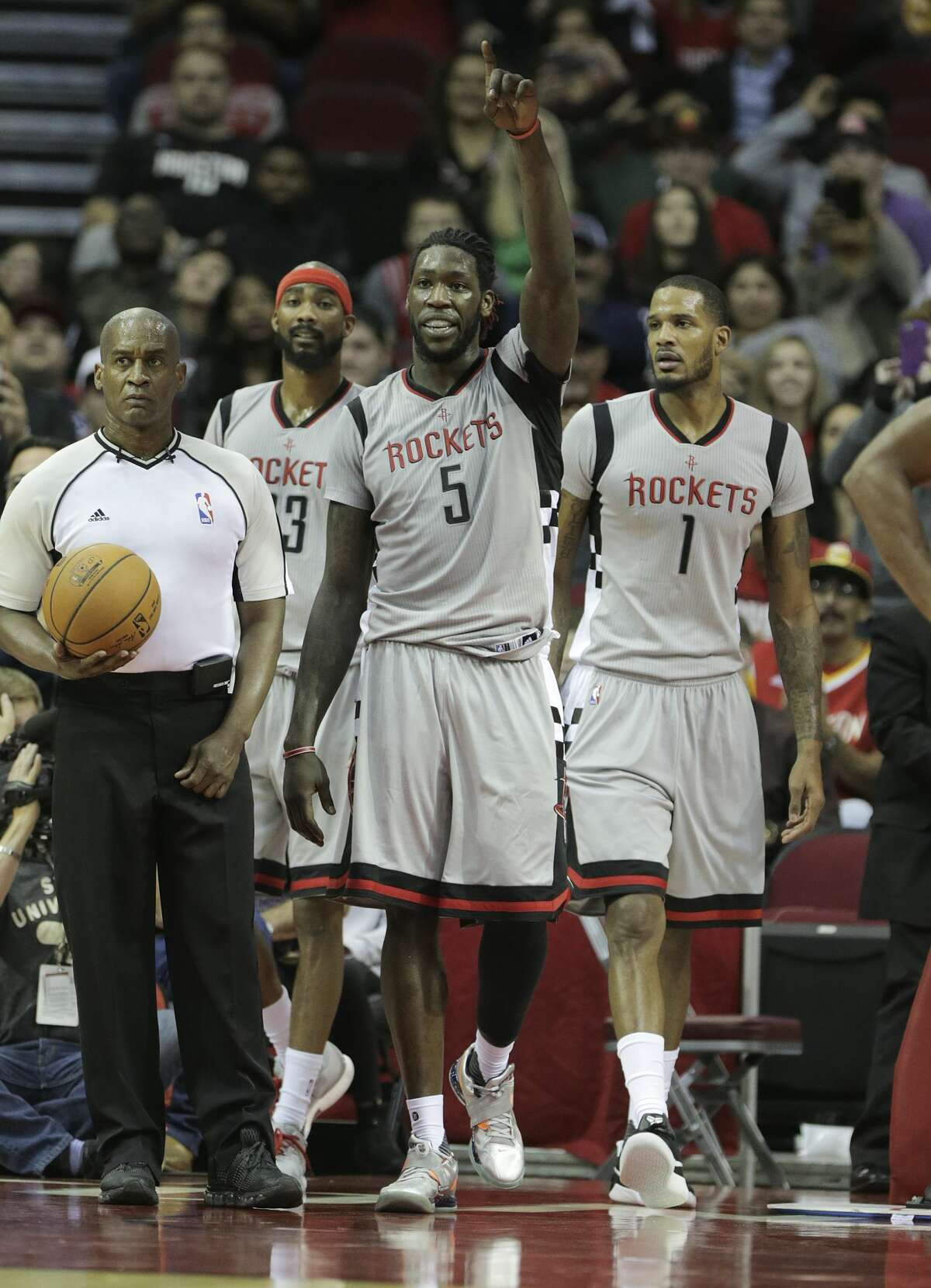 Houston Rockets forward Montrezl Harrell (5) points to teammate James Harden (13) after Harden's assist to Harrell gave him a triple-double in the team's 140-116 win over the Los Angeles Clippers on Friday, Dec. 30, 2016, in Houston. Rockets won the game 140-116.( Elizabeth Conley / Houston Chronicle )