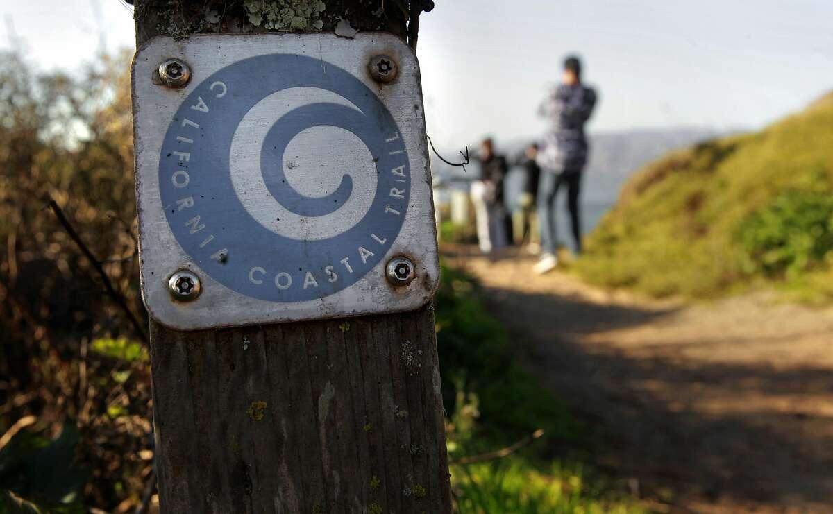 Visitors along the California Coastal Trail above Baker Beach in San Francisco, California, on Friday December 30, 2016.