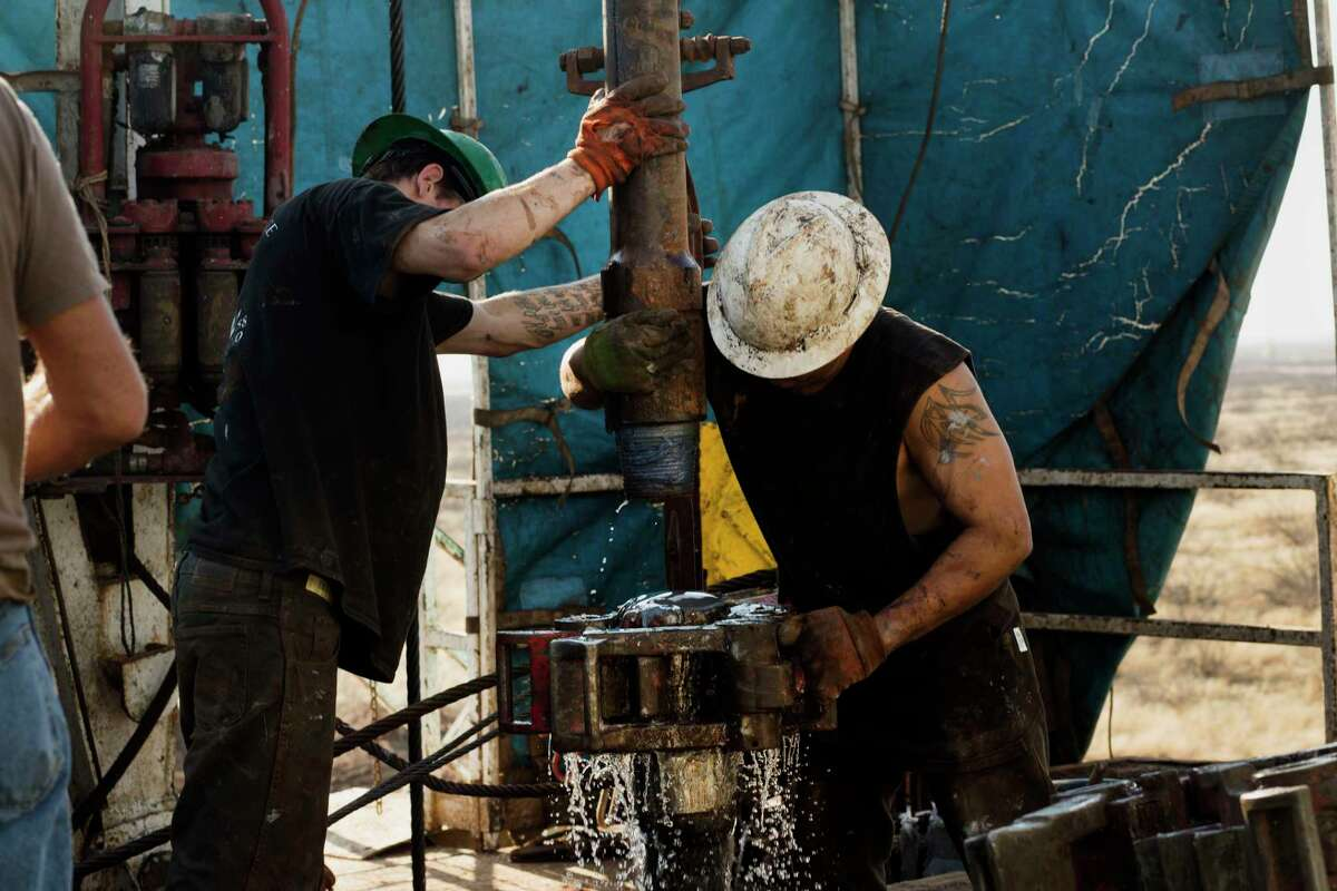 Workers connect drill bits and drill collars on a rig near Midland. CLEAR at the University of Texas at Arlington found that most companies work carefully to minimize the environmental impact.